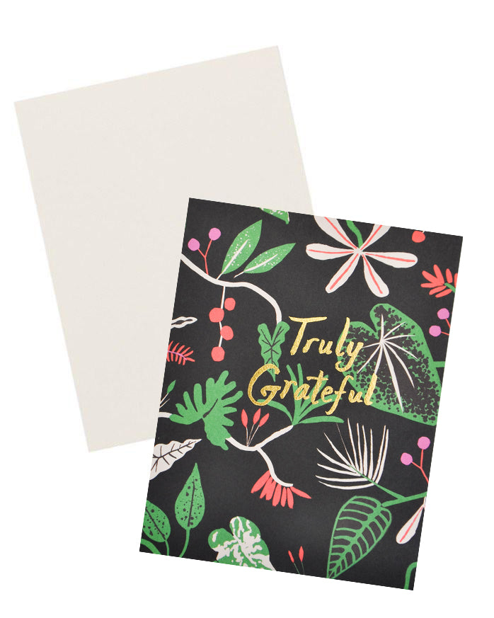 "3: Black greeting card with botanical print and ""Truly Grateful"" written in gold foil."