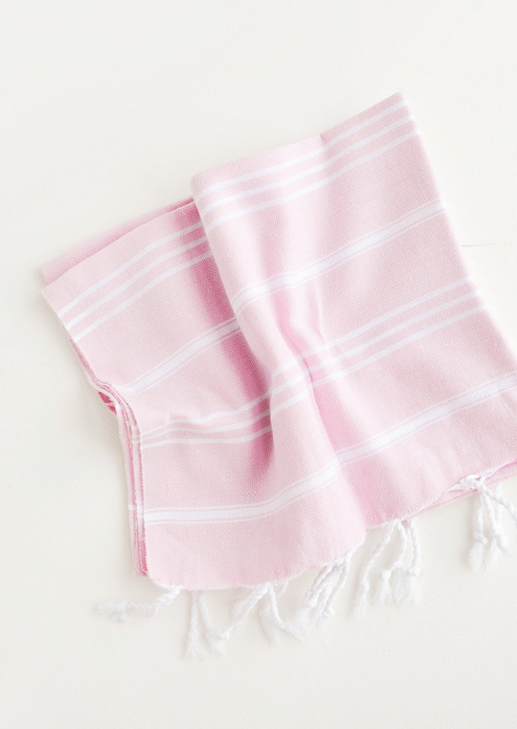 Pink / Hand Towel: Cotton towel with white stripes in pink, twisted fringe on ends