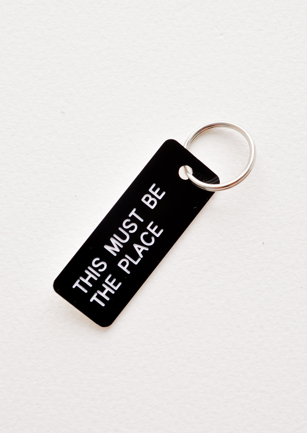 Words of Wisdom Keychain in This Must Be The Place - LEIF