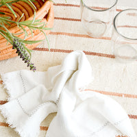 3: Serene table setting with neutral and white table linens and glass cups