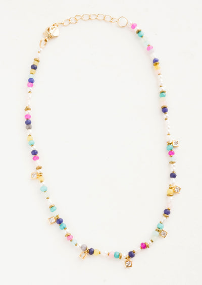 Beaded necklace with pearl and colored stone beads, accented with square crystal stations