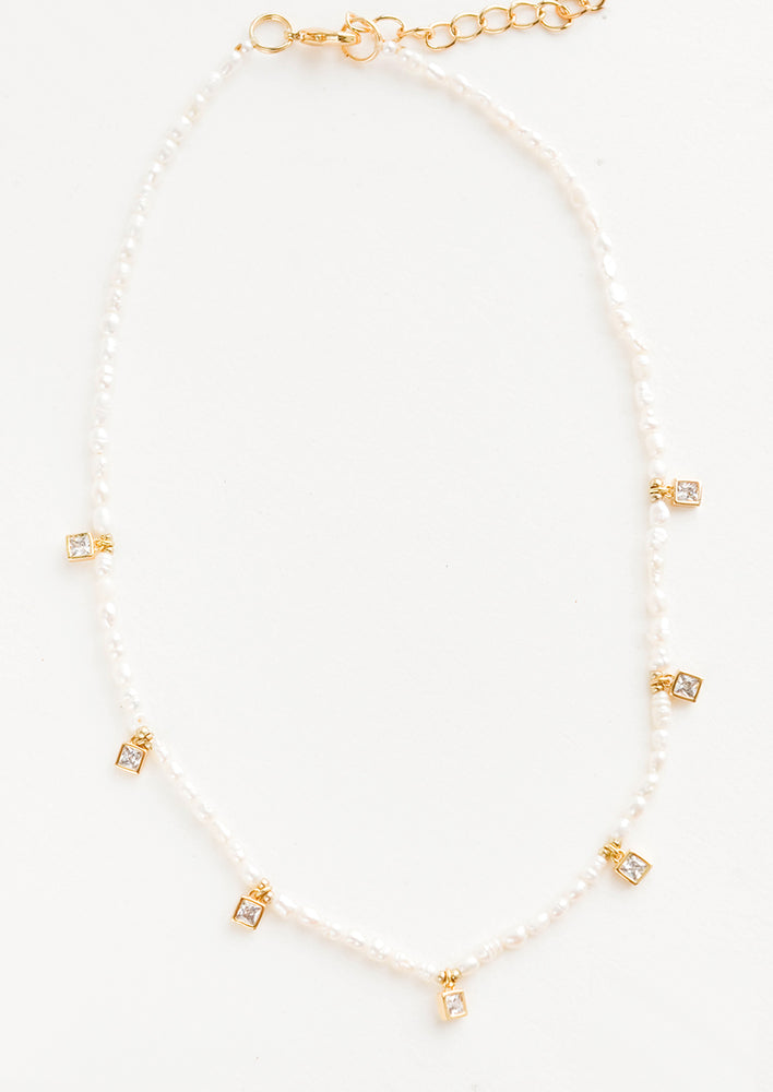 White / Gold: Pearl beaded necklace, accented with square crystal stations