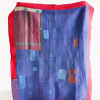 1: Vintage patchwork quilt in a mix of colors and fabrics. Predominantly dark blue with magenta accents.