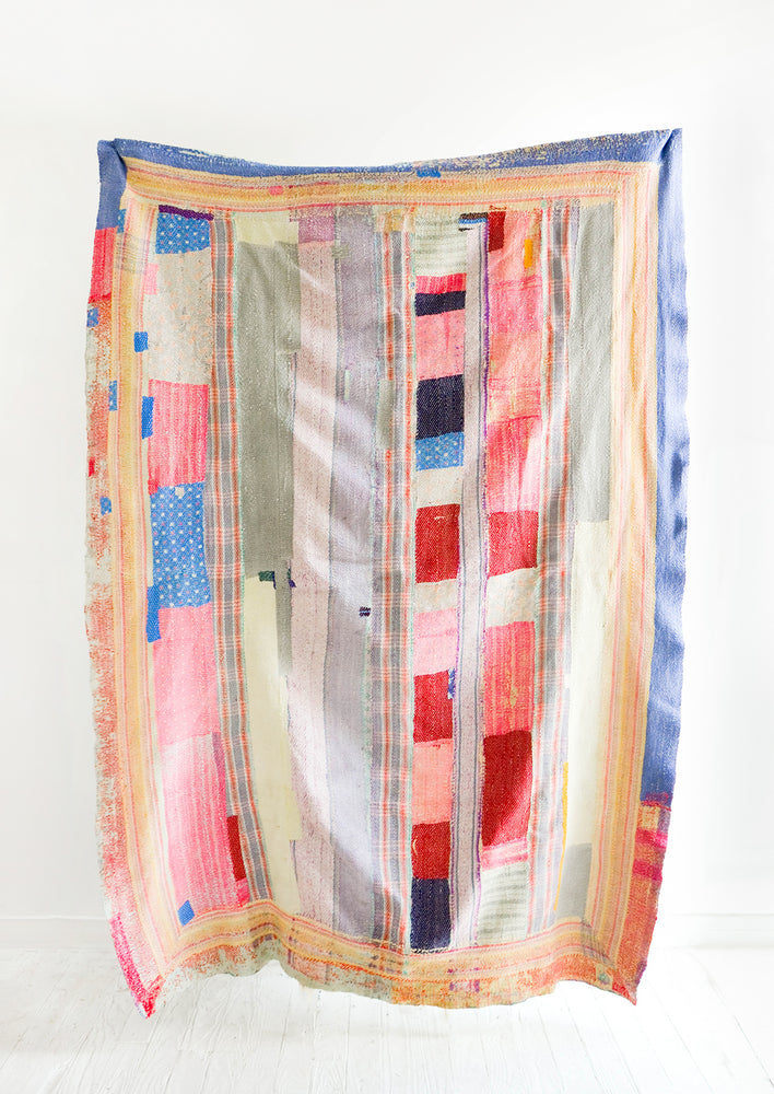 1: Vintage quilt with heavily patchworked design in blue, pink, red and various pastels