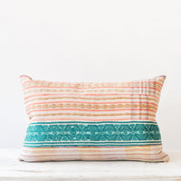 2: A multicolored pillow made of vintage quilt fabric.