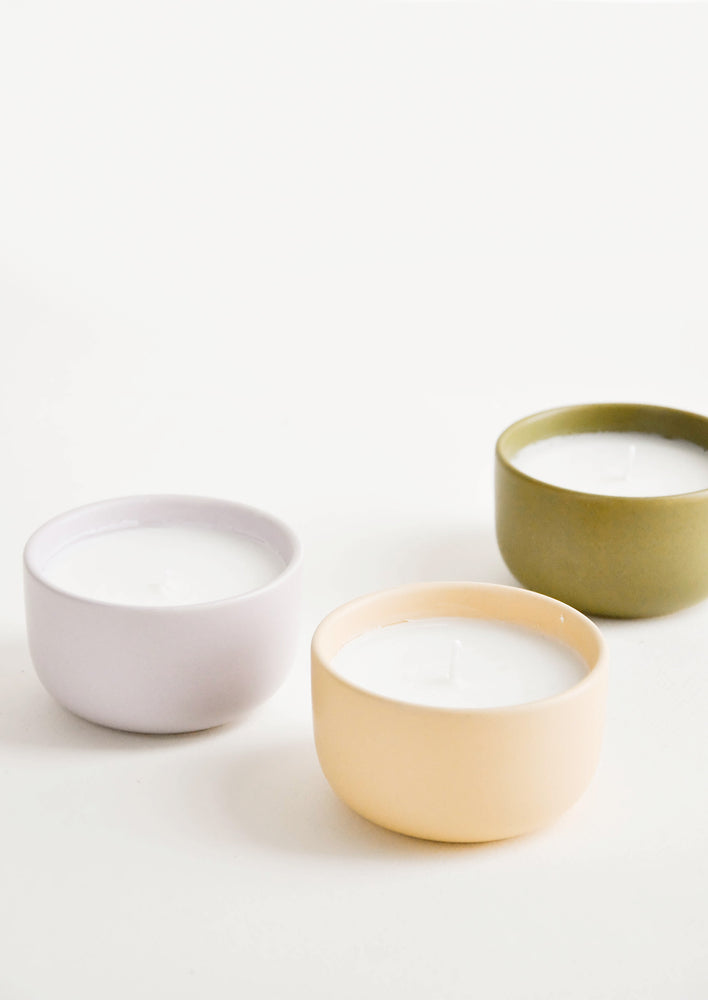 1: Small scented candles in colorful ceramic vessels