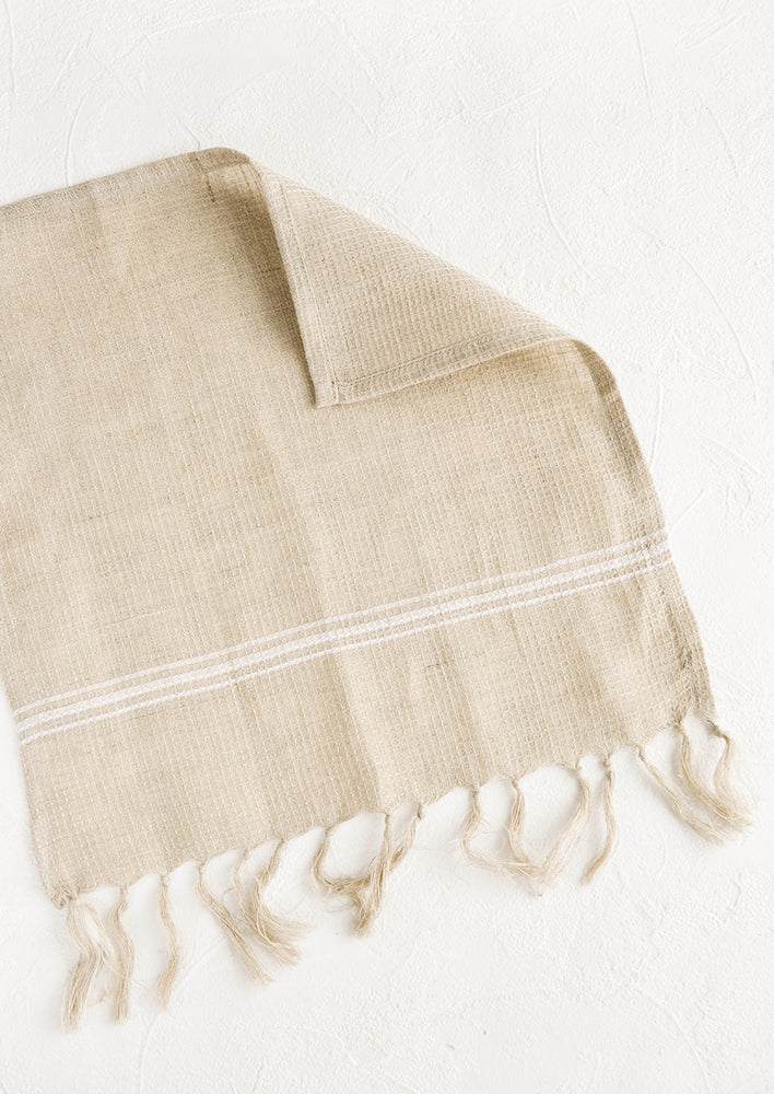 Natural: Waffle-textured dishcloths in natural color with single white stripe detail and tassel trim