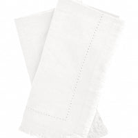 Parchment: Two folded ivory Cotton Napkins with frayed edges .