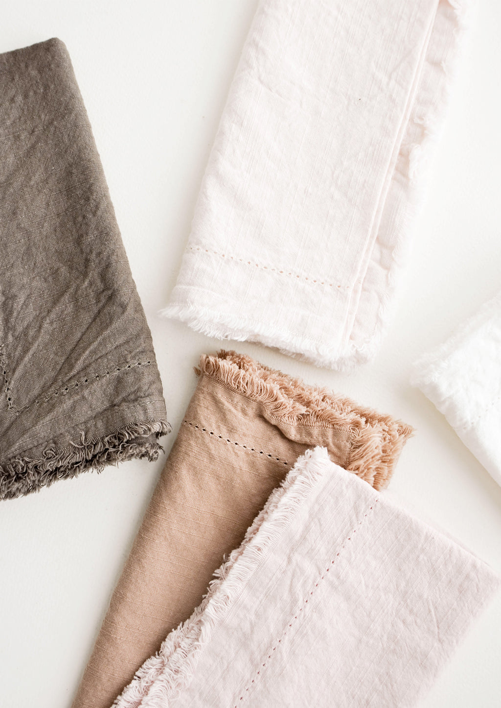 2:  Cotton Napkins with frayed edges in browns and pinks.