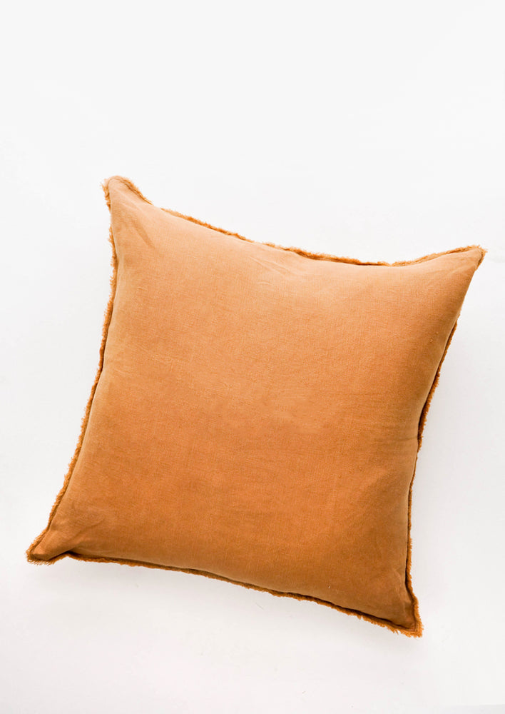 Amber: Linen Square Throw Pillow with Frayed Trim in Amber - LEIF