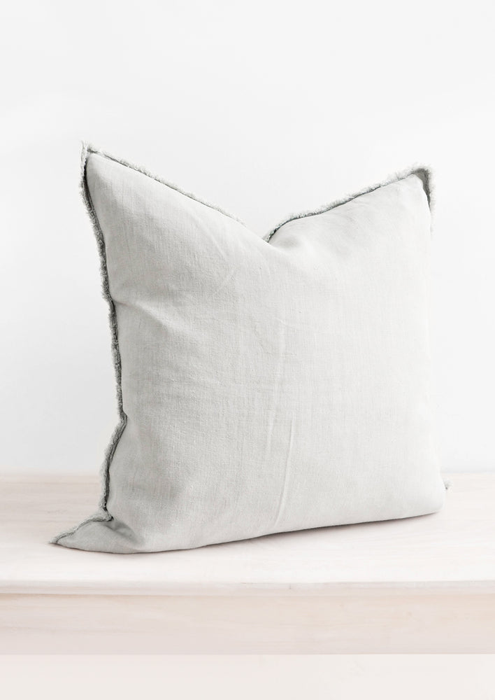 Seafoam: Square Linen Throw Pillow with Frayed Trim in Seafoam - LEIF