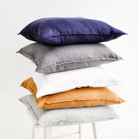 White: Stacked Image of Square Linen Throw Pillows with Frayed Trim
