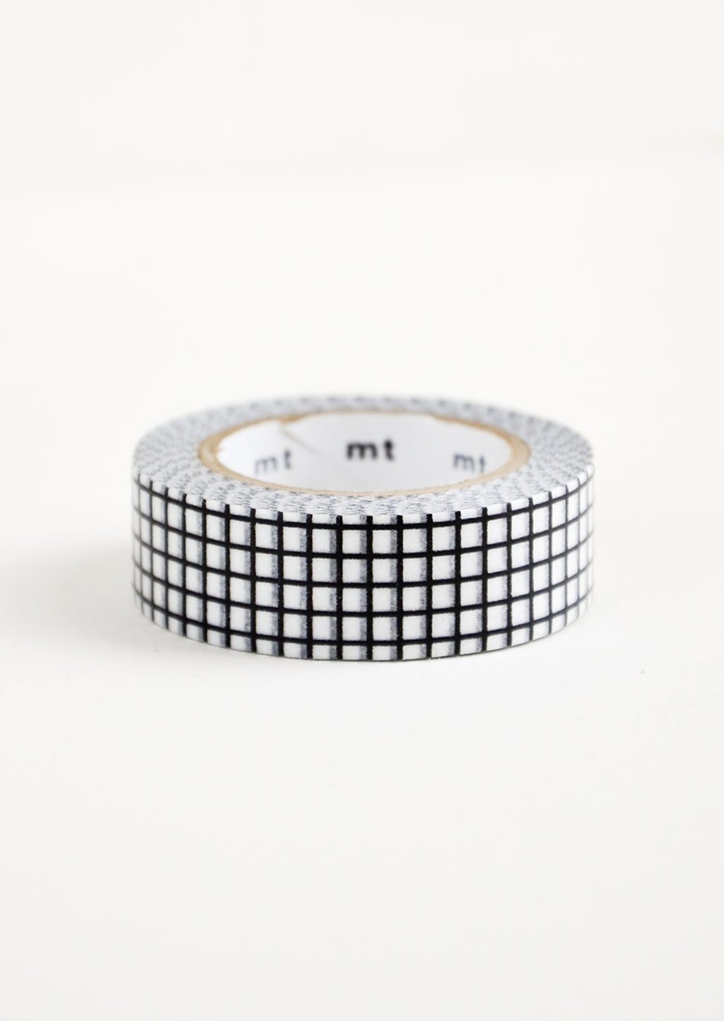 Black & White Grid: A roll of washi tape in a black and white grid pattern.