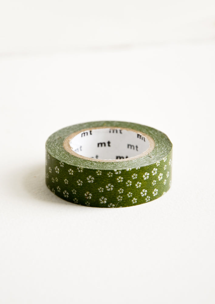 Green Sakura: A roll of washi tape with olive green background and white sakura flower print.