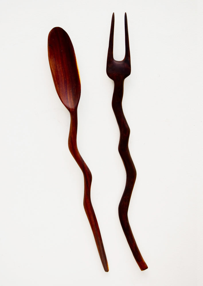 1: Two piece spoon and fork teak wood serving set, in a primitive silhouette with wavy handles