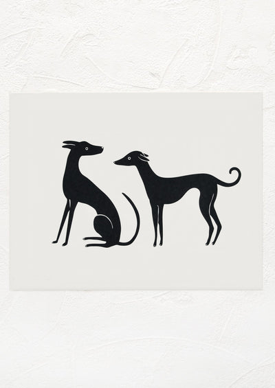 A black and white digital art print with imagery of two whippets.