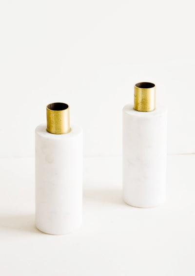 Solid white marble taper holders with brass top