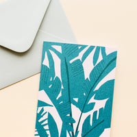 Palm: Pink notecard with drawing of a palm and light green envelope.