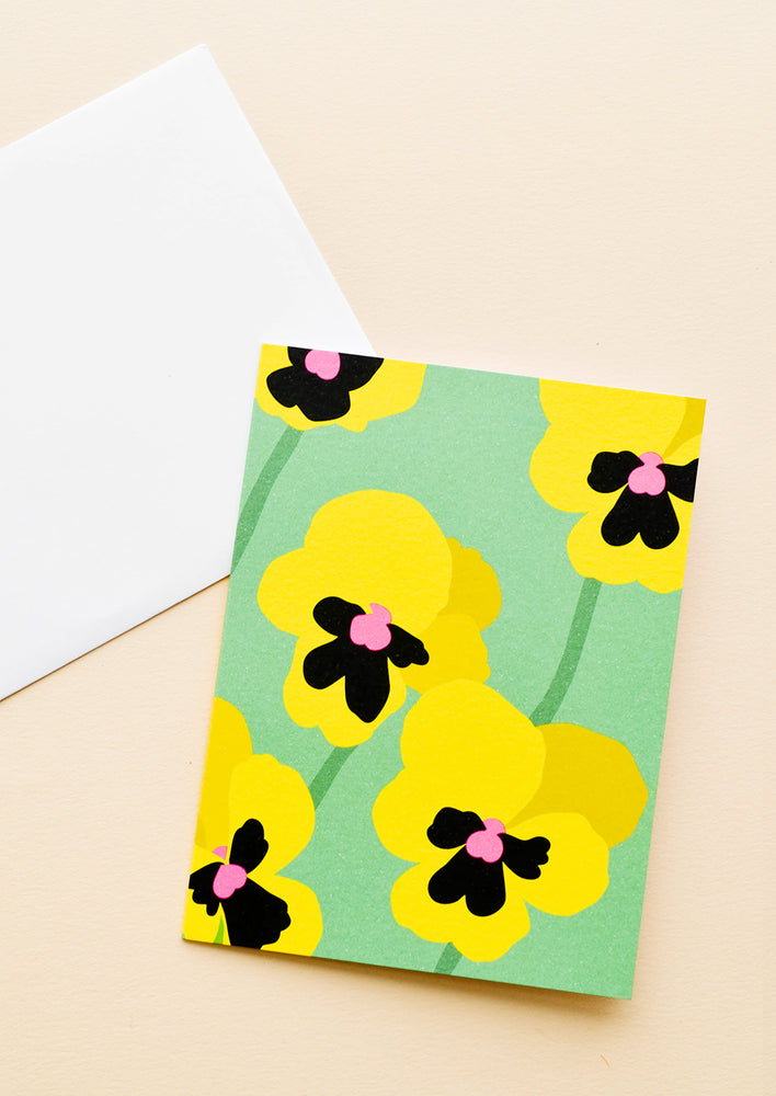 Pansy: Green notecard with colorful drawing of a pansy and white envelope.