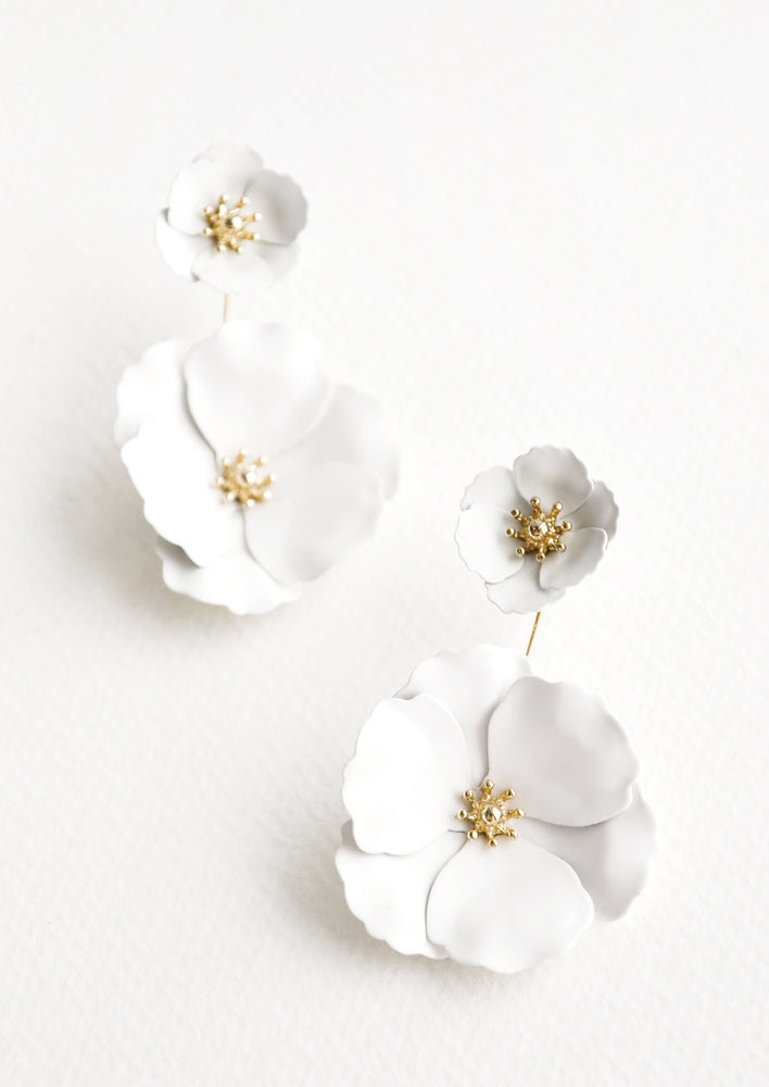 White: Two part true white and gold flower earrings with a small flower post and larger flower drop.