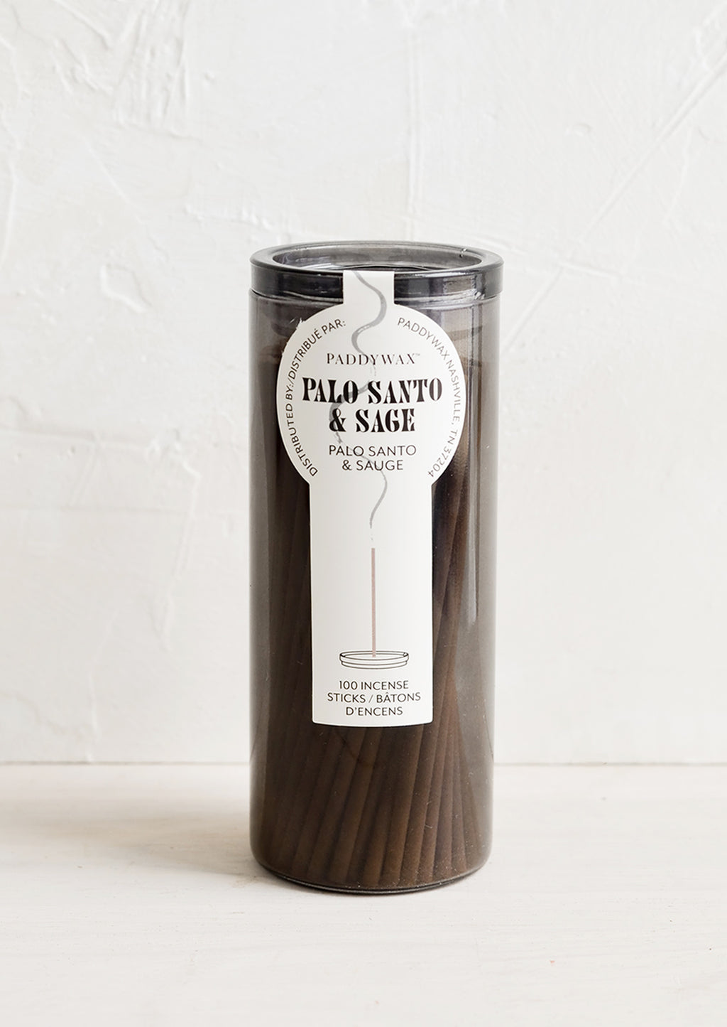 Palo Santo & Sage: A grey glass jar with incense sticks in palo santo scent.