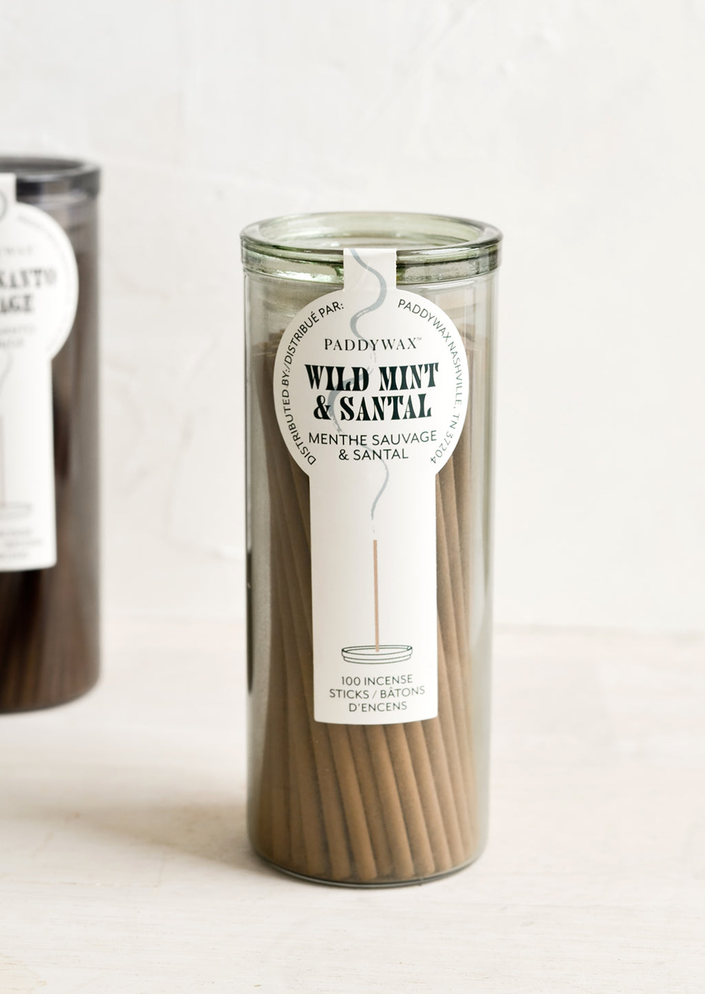 Wild Mint & Santal: A green glass jar with incense sticks in wild mint scent.
