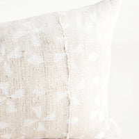 2: Rectangular lumbar pillow in beige mudcloth with allover white windmill pattern