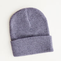 Slate: A purple knit beanie with silver thread giving it a metallic sheen.