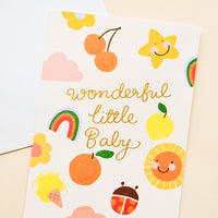 "1: Greeting card with illustrated shapes and ""wonderful little baby"" written in gold foil."
