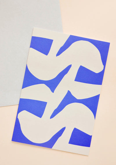 Notecard with abstract cobalt and white design, and grey envelope.