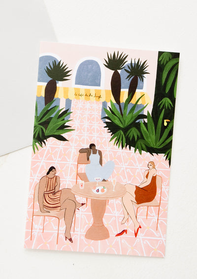 Oversized greeting card picturing women sitting at an outdoor cafe