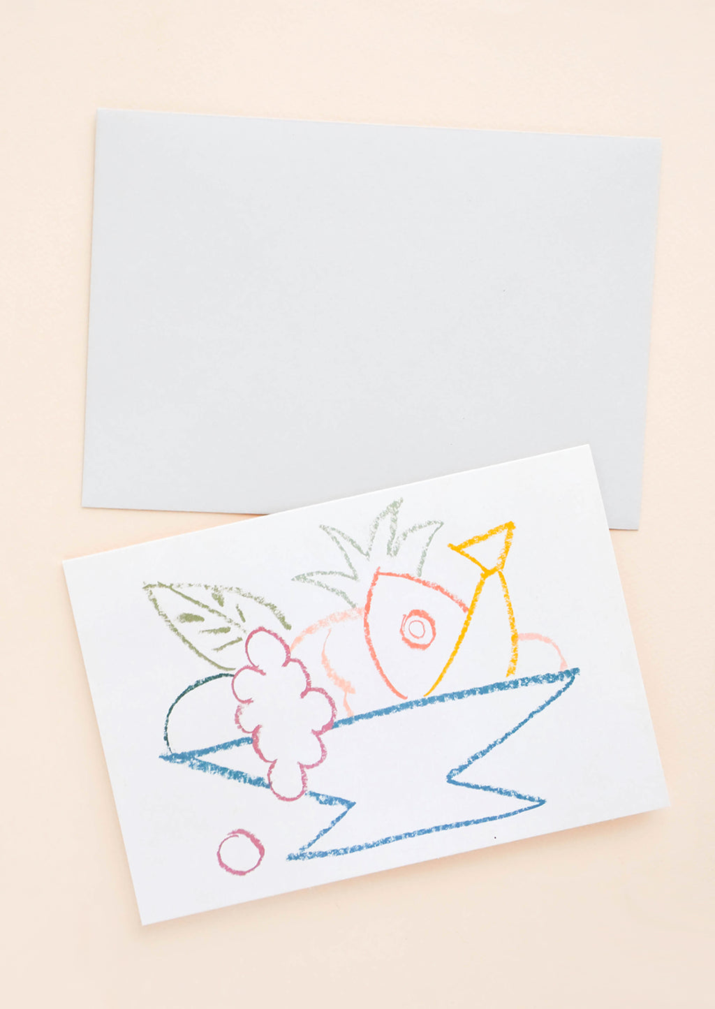 1: A horizontal greeting card featuring a colorful yet simplistic drawing of fruit in a bowl alongside an off-white envelope.