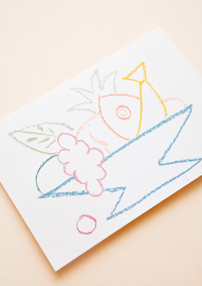 2: A horizontal greeting card featuring a colorful yet simplistic drawing of fruit in a bowl.