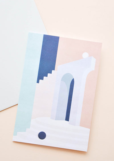 Notecard with pastel architectural scene, and white envelope.