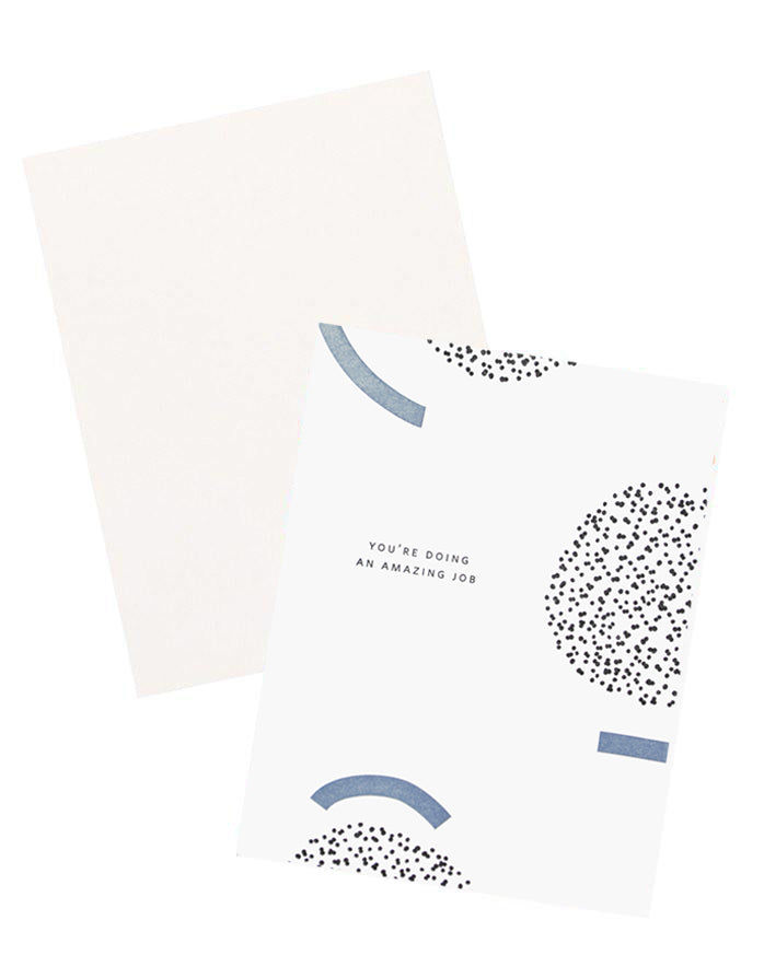 "2: White notecard with black and blue geometric decoration and the text ""You're doing an amazing job"", with white envelope."