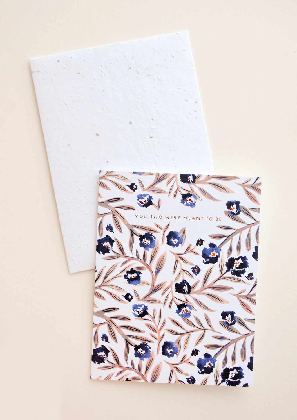 "1: Notecards with blue flowers and brown stems and the text ""You Two Were Meant To Be"", with white envelope."