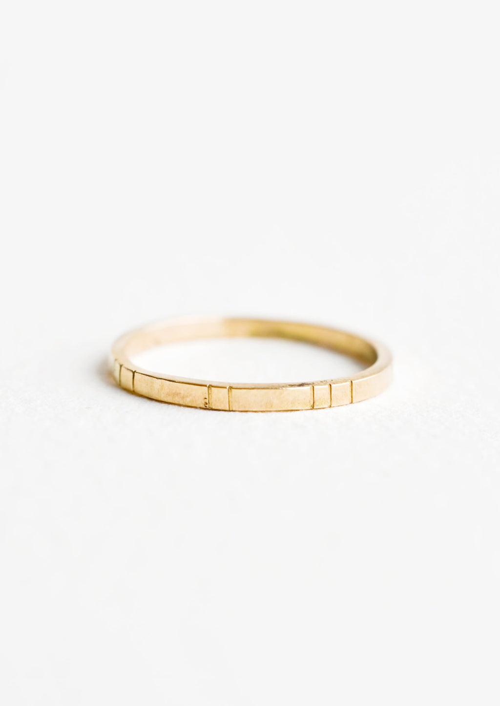 1: Yellow gold ring, medium weight band with etched decorative lines.