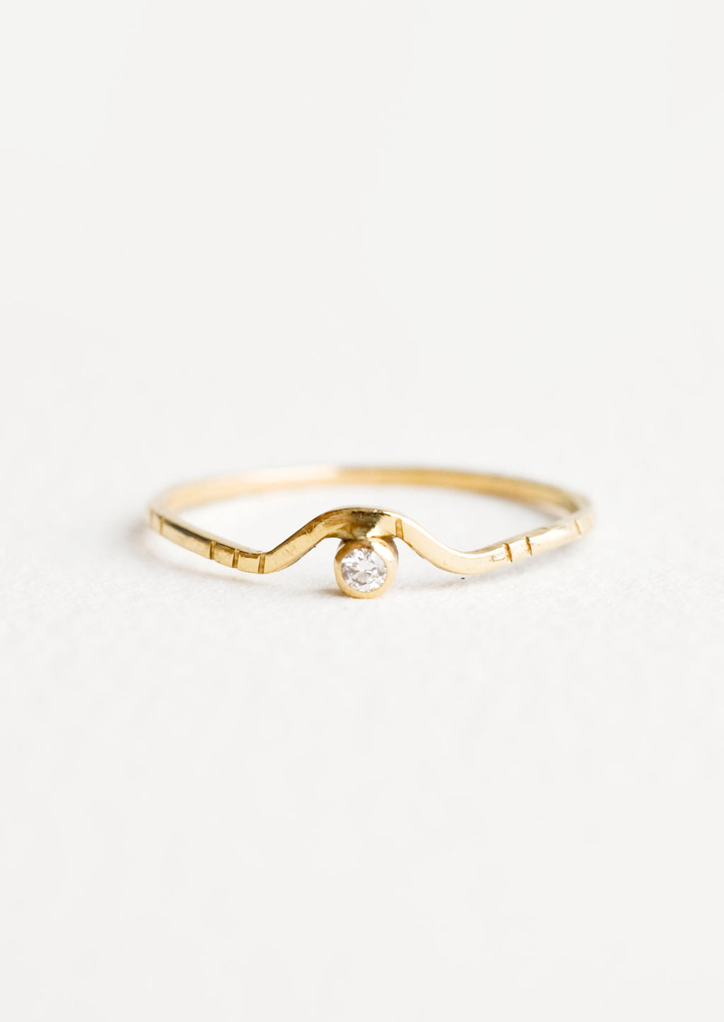 1: Yellow gold ring with etched decorative lines and a diamond set into an arched front.