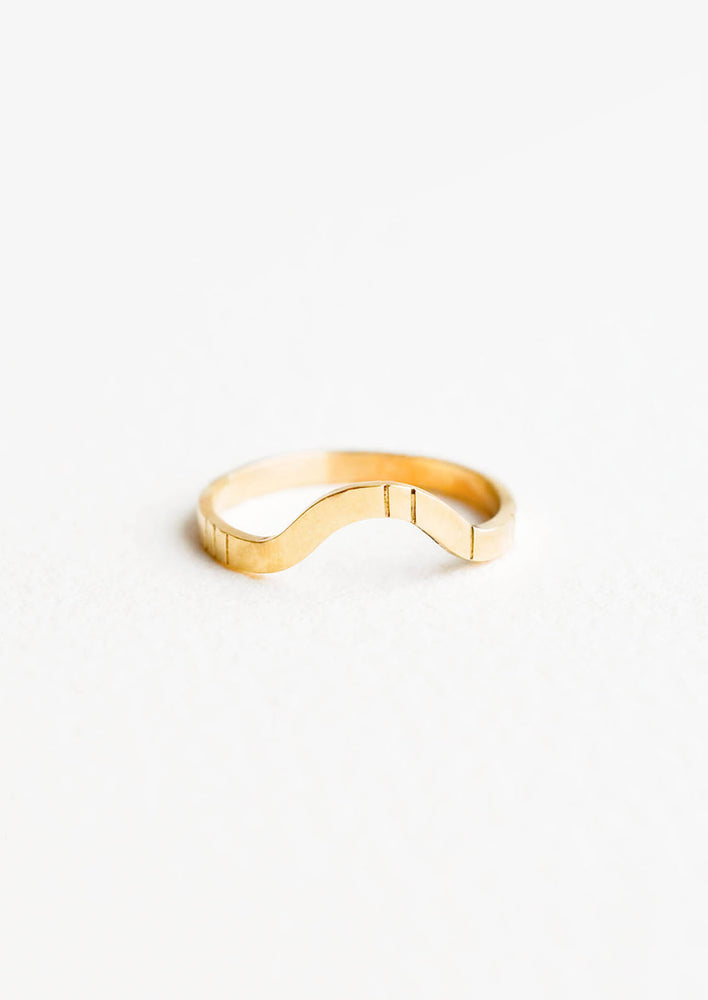 1: Yellow gold ring with medium size band, arced front, and etched decorative lines.