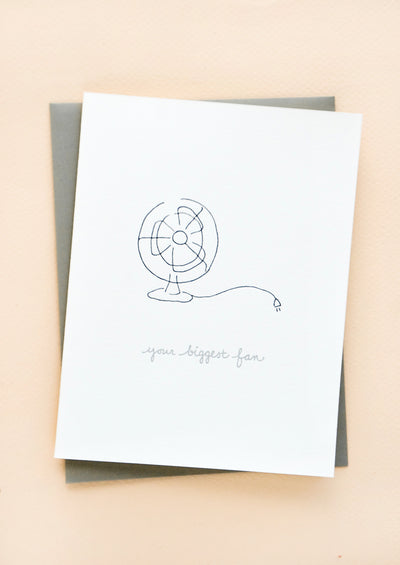 "Greeting card with letterpress printed fan and grey cursive text reading ""Your Biggest Fan"". With grey envelope."