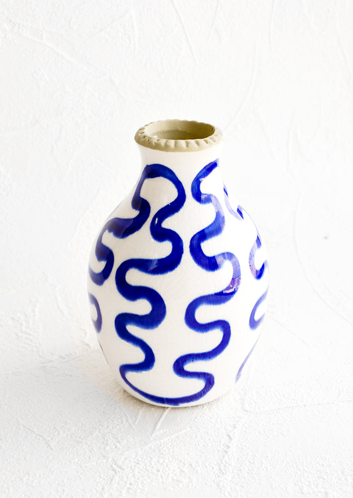 2: Tall bud vase in glossy white ceramic with cobalt blue squiggle print