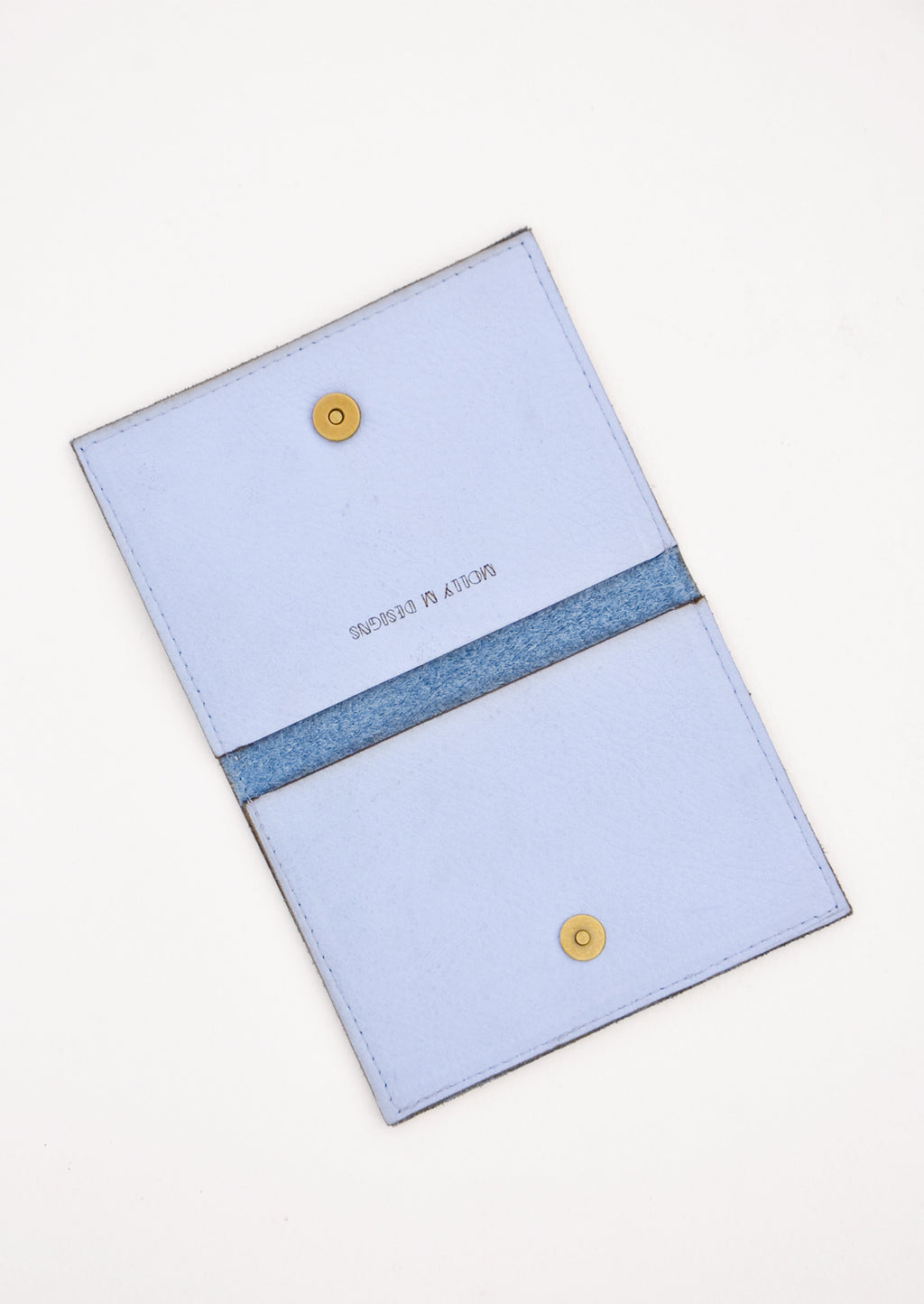 2: Slim blue leather wallet with two interior slip pockets that folds closed with a snap, shown open in