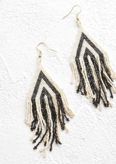 Triangular earrings made from black & white seed beads with fringed bottom