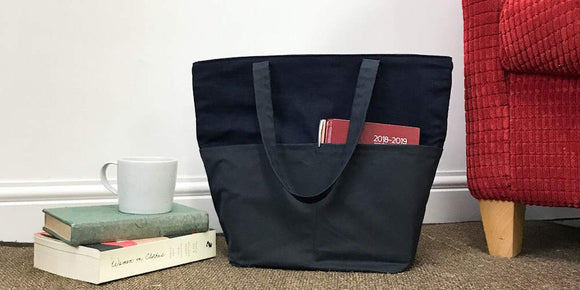 Linen and waxed cotton tote bag with pockets.