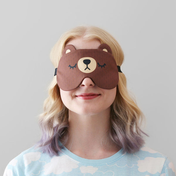 Woman modelling brown bear sleep mask