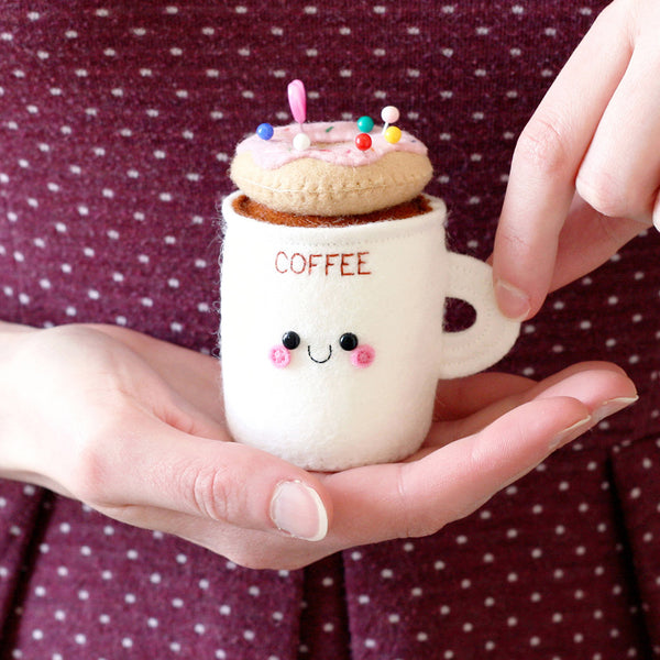 coffee cup pincushion with donut on top, by hannahdoodle