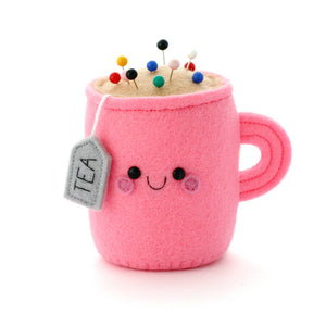 Bright pink teacup pincushion