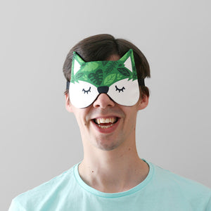 Man wearing fox mask with green leaves pattern