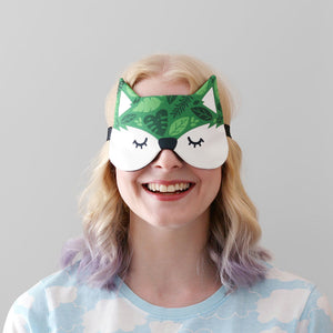 Woman wearing green leafy fox mask