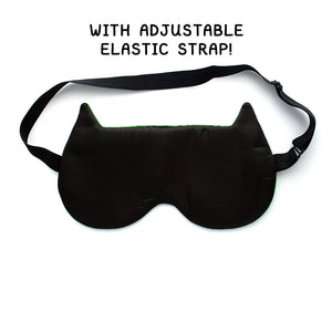 Back of sleep mask showing adjustable elastic and soft black satin